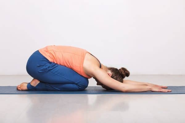 Child's pose position used to decrease lower back pain.